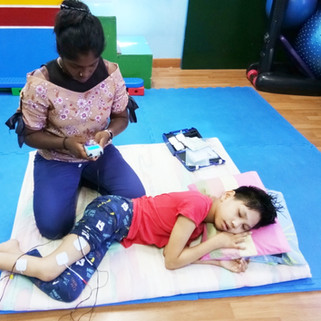 Physiotherapist, Ms, Senta, from Louis Center Seremban, tens muscle and nerve stimulator sound during physiotherapy with cp child. Cerebral Palsy