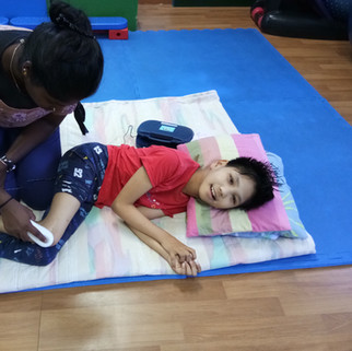 Physiotherapy at Louis Center Seremban, using the ultra sound during physiotherapy with cp child. Cerebral Palsy