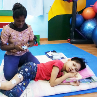 Psysiotherapist senta working on our beautiful child with CP at louis center seremban