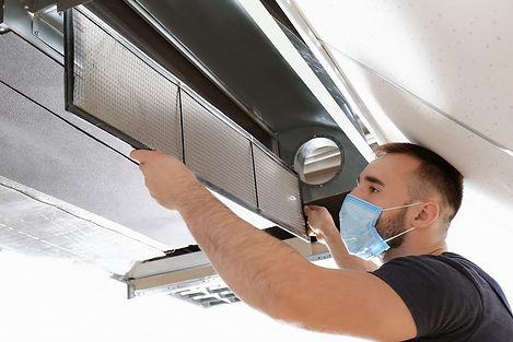 bigstock-Male-technician-cleaning-indus-