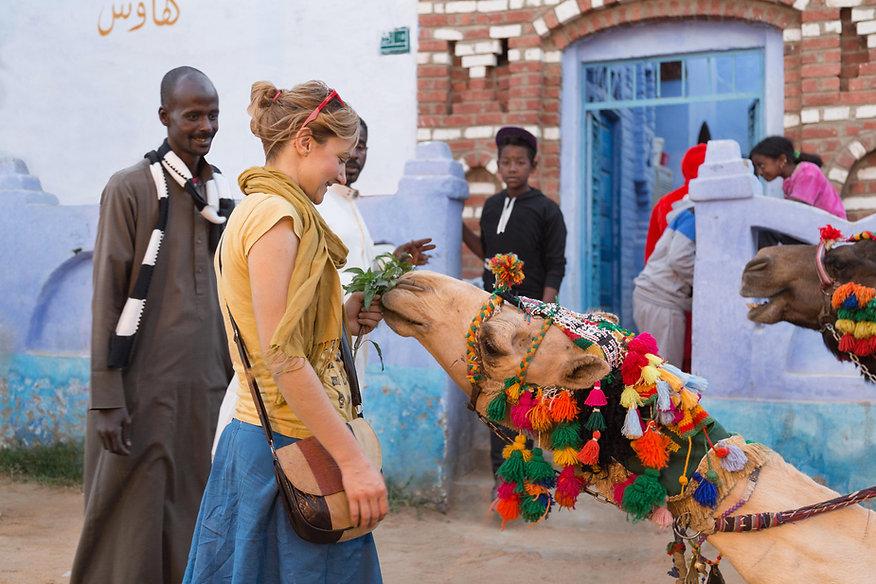 EG_Aswan_Feeding camel in Nubian village
