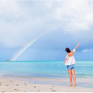#34 lady on beach with rainbow.png