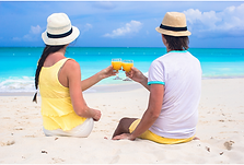 #24 couple sitting on beach with drink.p