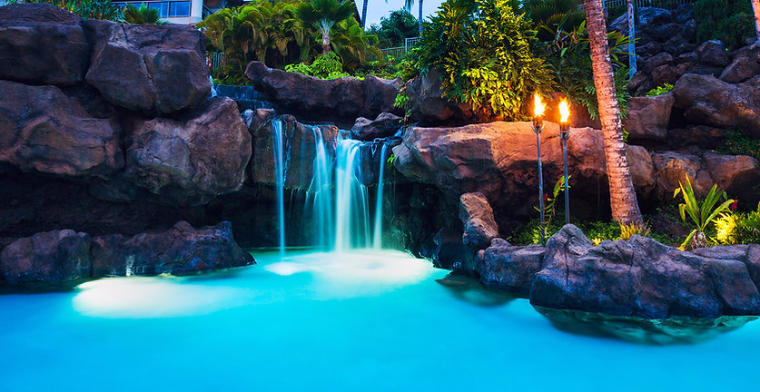 Pool and Waterfall at Sunset in Hawaii.j