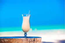 #47 pina colada drink on beach.png
