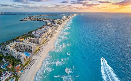 Cancun coast with sun.jpg