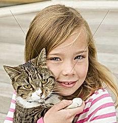 smiling-girl-holding-cat-outdoors.jpg