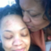 A picture of a Mother kissing Daughter