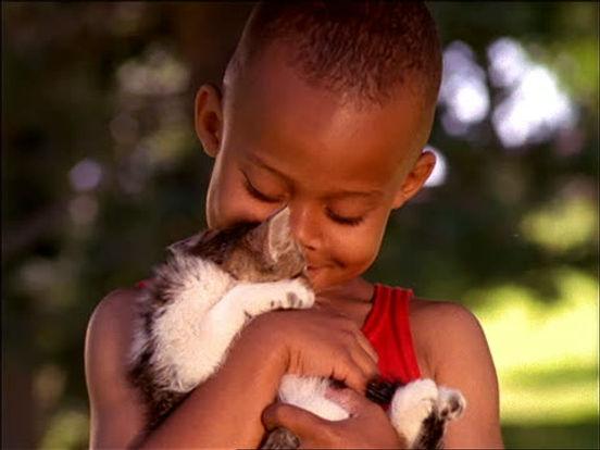little black boy holding a kitten.jpg