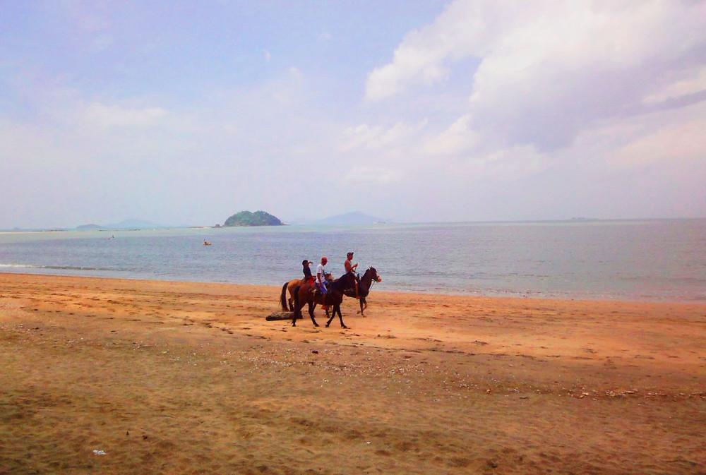 Horseback riding on Panama beach