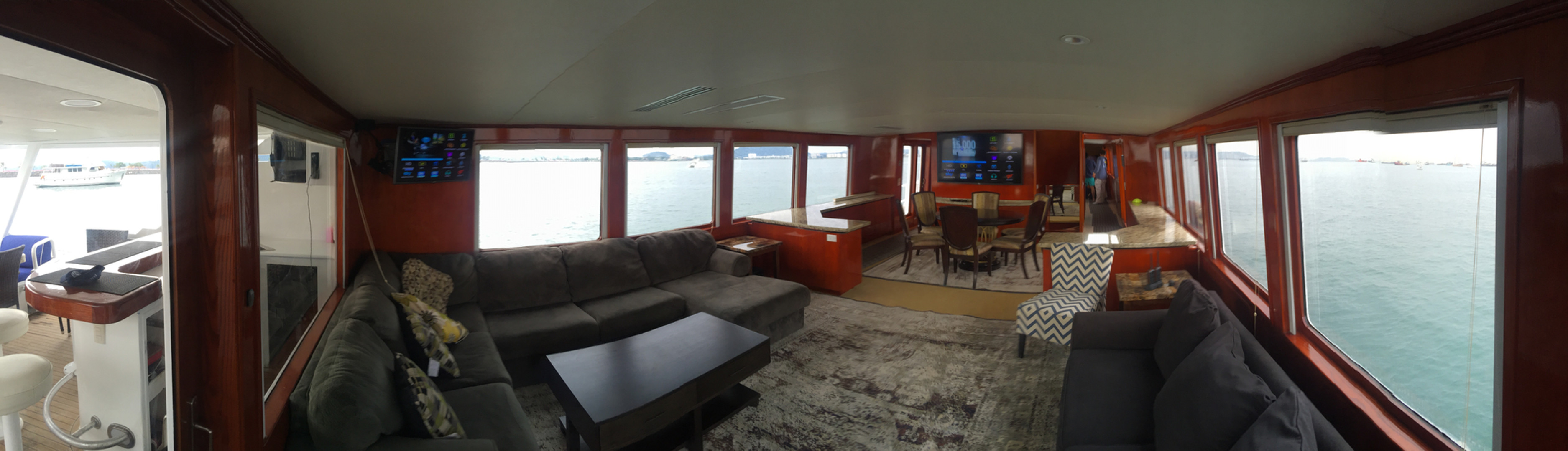 living room of 105ft broward yacht for charter in panama