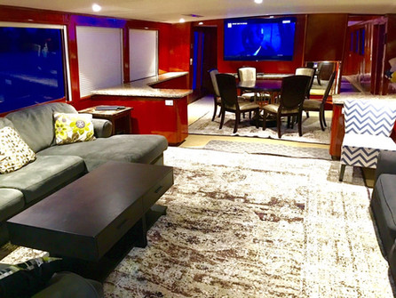 living room on 105ft broward yacht for charter in panama