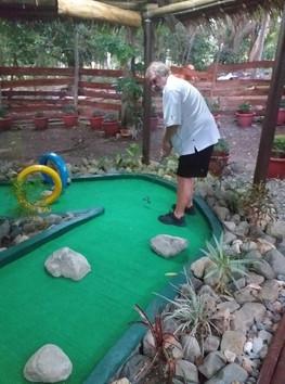 enjoying the mini golf course