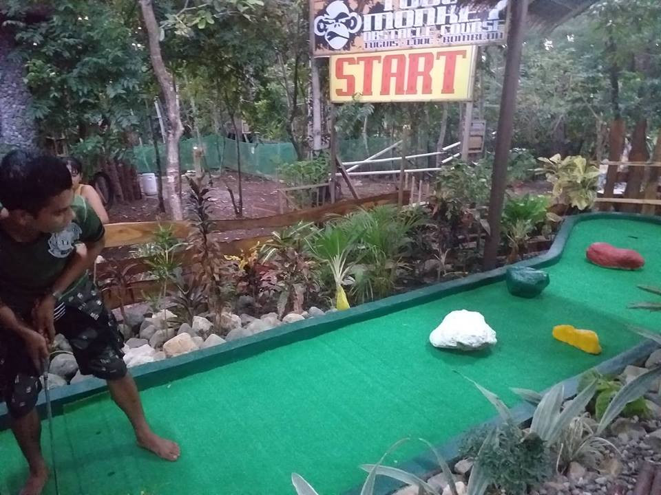 Guests playing mini golf