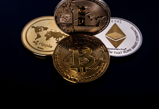 four-assorted-cryptocurrency-coins-84370
