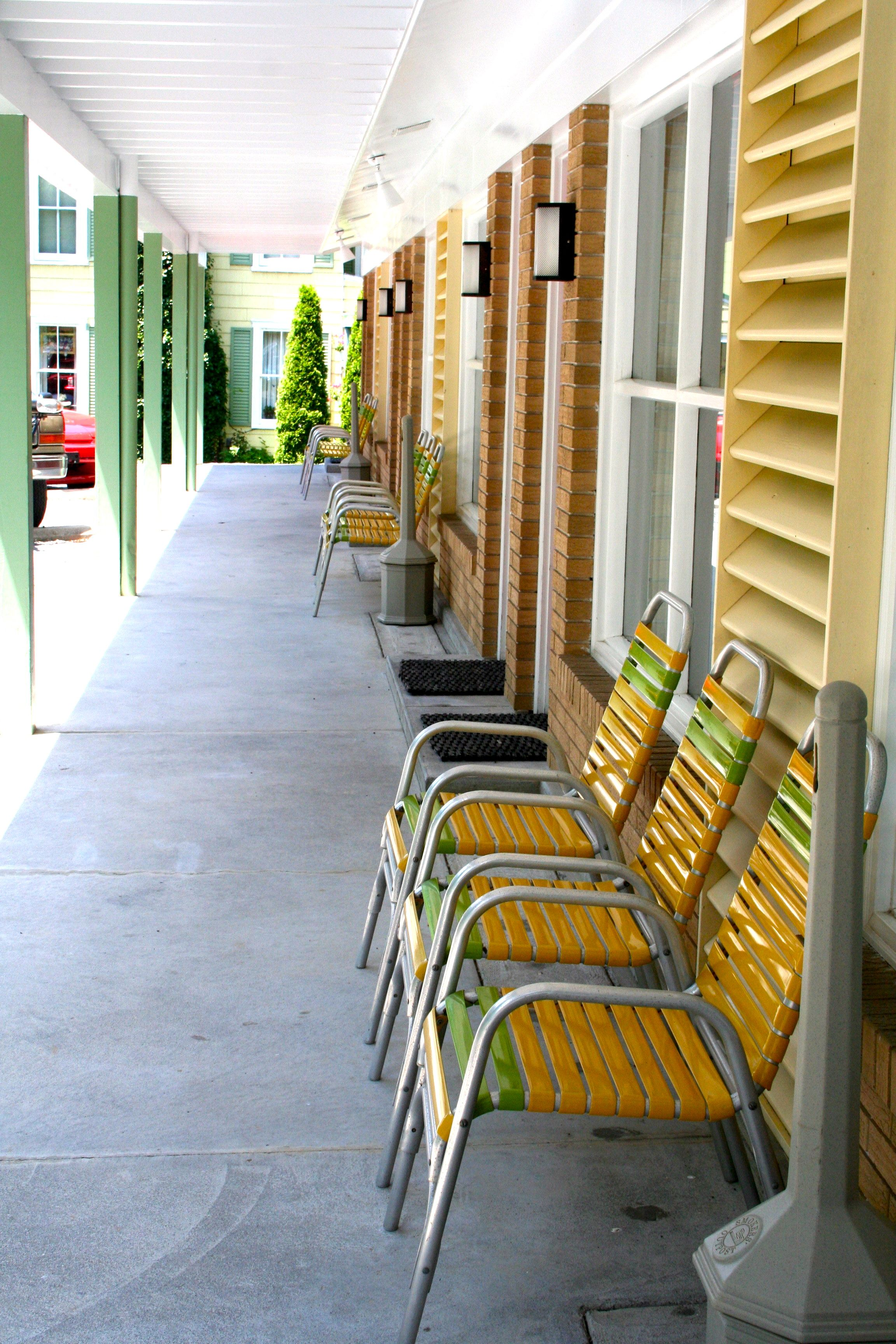 Patio furniture in front of rooms