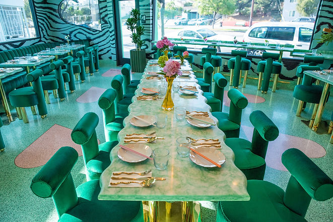 the interior space of the restaurant featuring our jade green tables and terrazzo floors