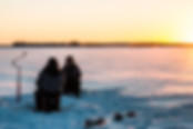 Ice-fishing-on-a-frozen-lake-Rovaniemi-L