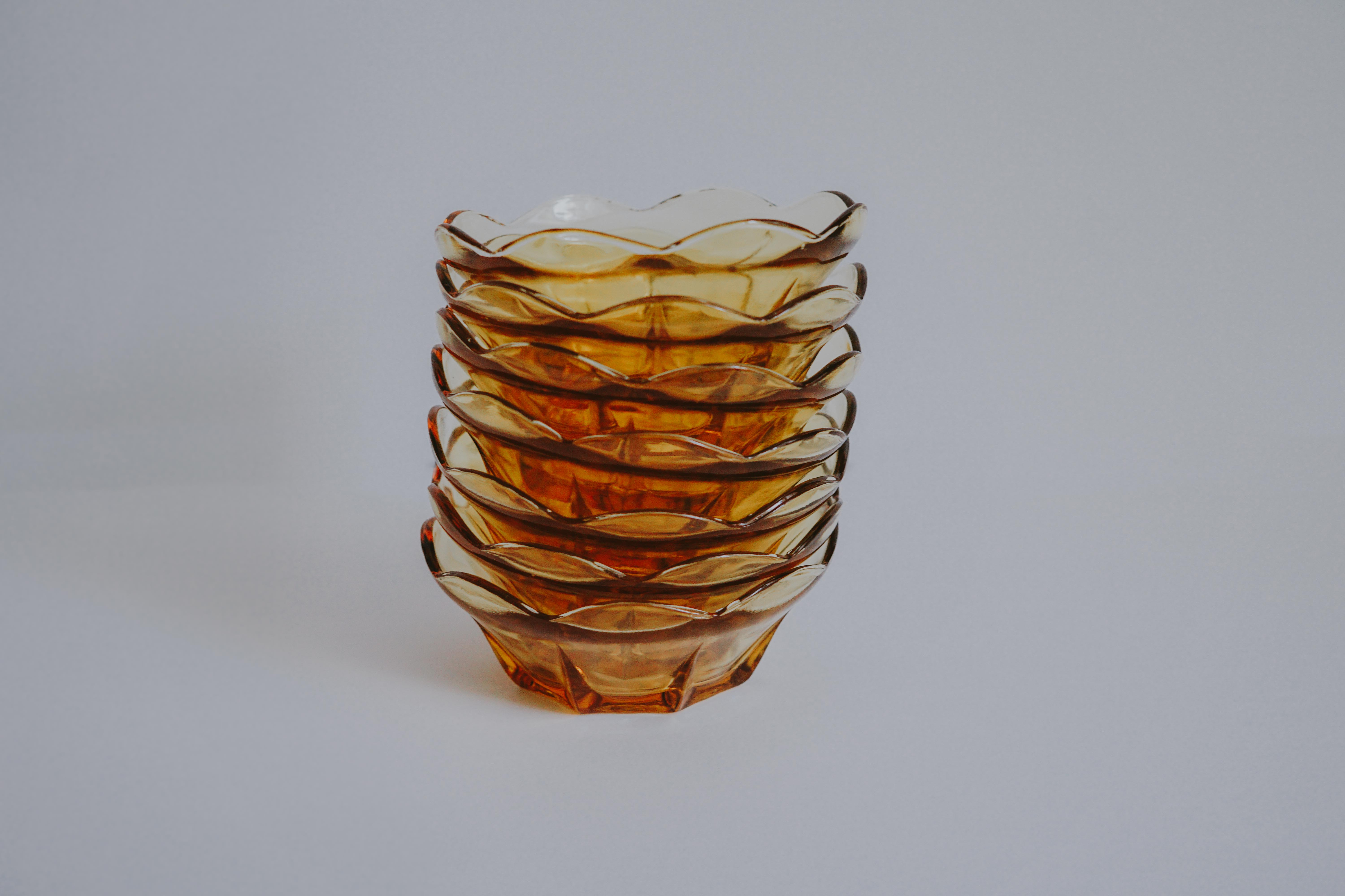 MIDCENTURY MODERN AMBER COLORED GLASS BOWLS SET OF 8