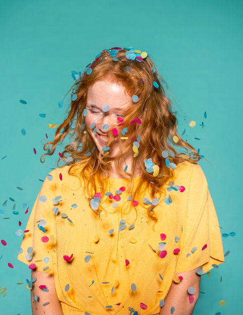 happy-redhead-woman-partying-with-confet