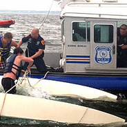 Marine Bureau Officers and Good Samaritan Rescue Teens from Overturned Boat