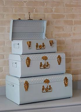 Beautiful blue metal suitcase boxes wedding rental