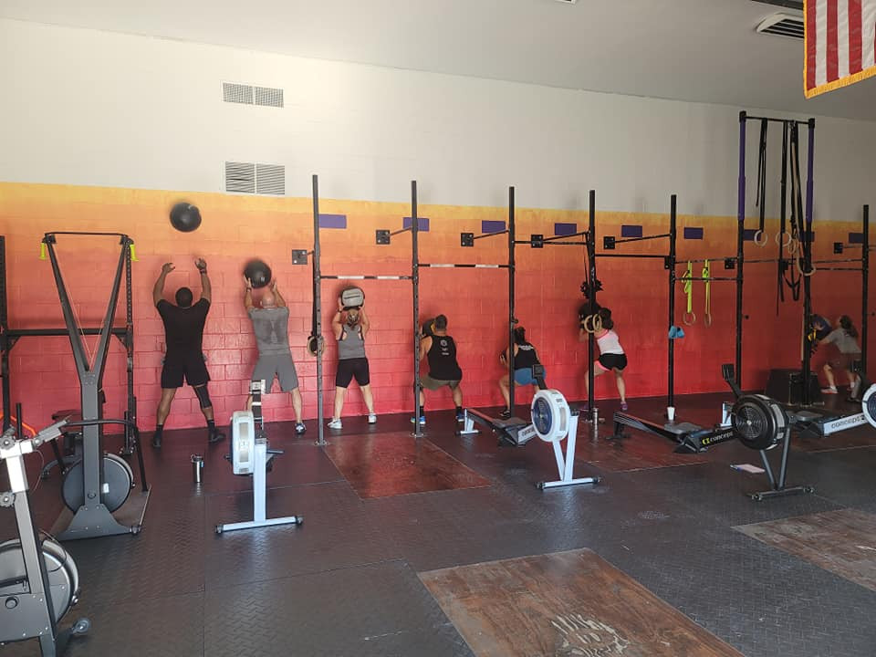 CrossFit athletes performing wallballs at Obscurus CrossFit.