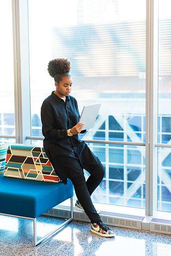 woman-in-black-jacket-standing-near-blue