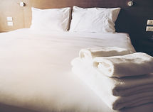 White bedding and towel set in modern ho