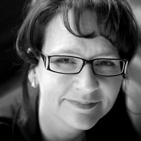 Black and white portrait of Melinda Mills