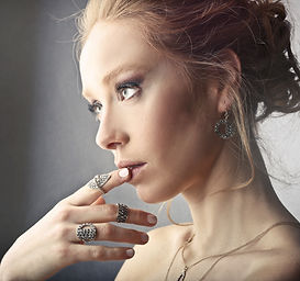 Canva - Woman Wearing Rings and Earrings