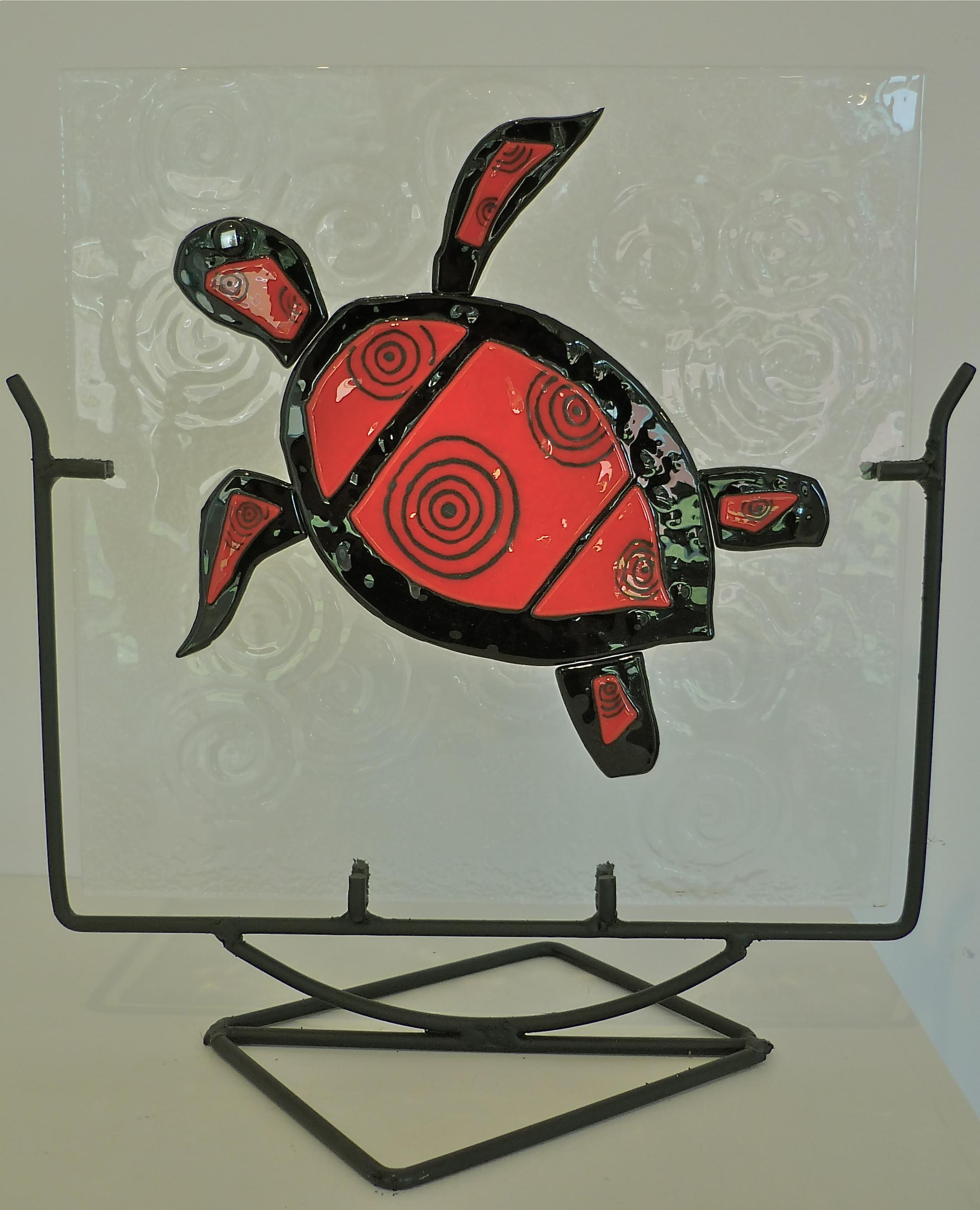 Swimming turtle flame on black