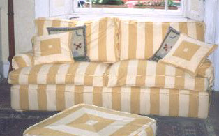 Stripe sofa and footstool covers.