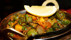 Bhindi Masala  Fresh okra delicately spiced cooked with tomatoes and onions