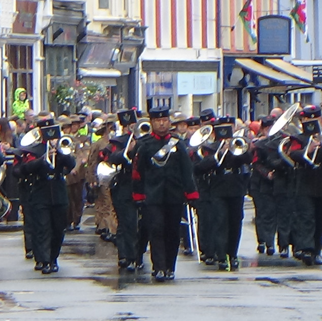 The Band of the Brigade of Gurkhas marching through Brecon