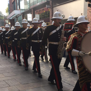 The band marching in to Cabot Circus
