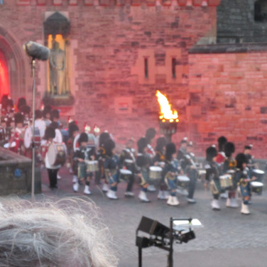 The drummers march over the famous castle Drawbridge and onto the esplanade