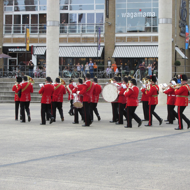 The Band of the King's Division 'right wheeling' on the Roald Dahl Plass
