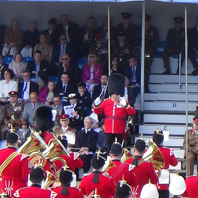 Major Denis Burton MBE, Direcot of Music of the Regimental Band and Corps of Drums of the Royal Welsh conducts the massed bands