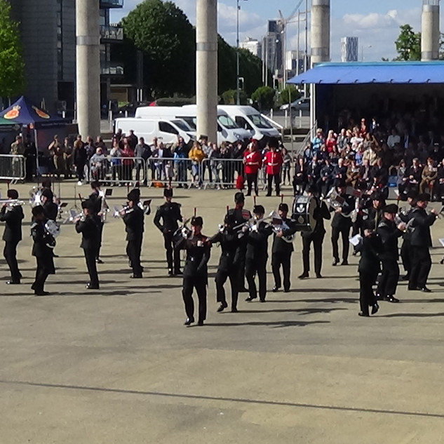 The Band and Bugles of the Rifles marching