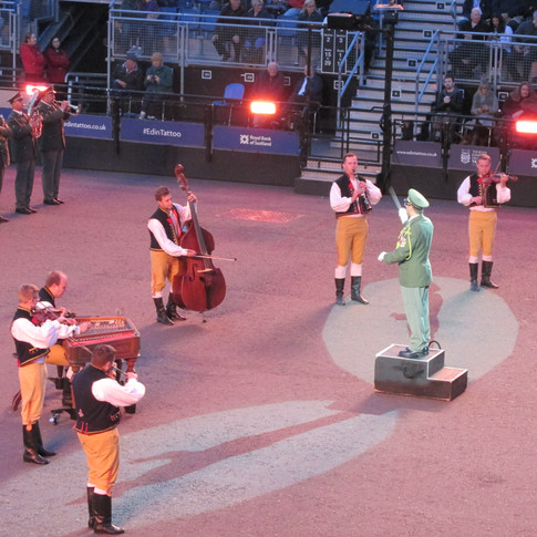 Members of The Ondras Military Arts Ensemble playing traditional Czech instruments to accompany the band and dancers.
