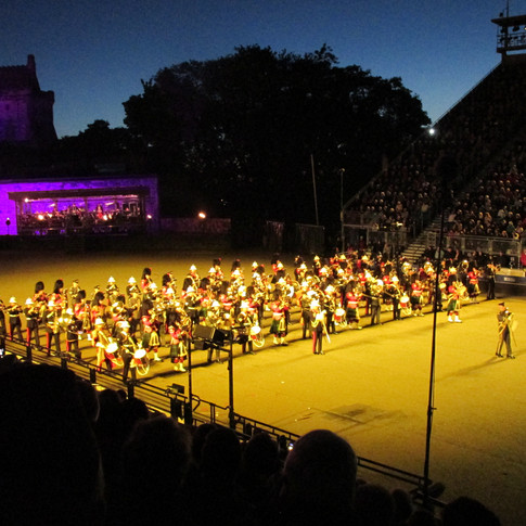 The Band of The RAF College, The Band of HM Royal Marines Plymouth and The Band of the Royal Regiment of Scotrland performing their dirplsay, accompanied by the stage band; formed from The Countess of Wessex's Stinrg Ocrehstra and The REME Band.