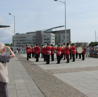 The Band of the King's Division performing in a blustry Cardiff Bay