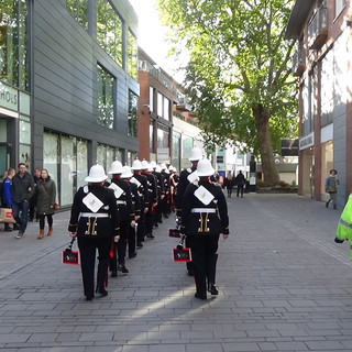 The Band of HM Royal Marines Plymouth marching into the distance, towards the Galleries shopping Cenetr in Bristol, back to where they were based for the day