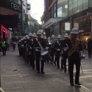 The Band of HM Royal Marines Plymouth arriving into Cabot Circus by drumbeat, byt their Corps of Drums