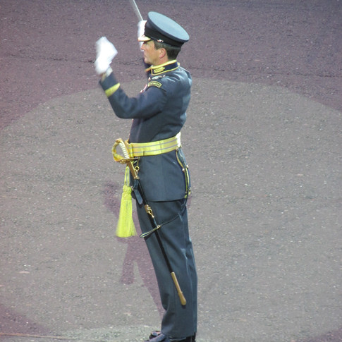 Squadron Leader Richard Murray, the Director of Music of The Band of the RAF College conducting the Opening Fanfare