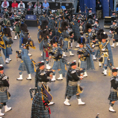 The Massed Pieps and Drums performing in the 2018 Royal Edinburgh Military Tattoo. Pictrued here are members of The Pipers Trail (left and right) and central are The Central Pipes and Drums of the Royal Air Force in Scotland.