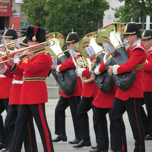 The Band of the King's Division Trombones and Tuba ranks with a trombinist from The Band of the Royal Corps of Signals