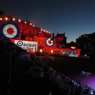 Images of The Royal Air Force being projected onto the castle walls during the tri-service bands perfomance