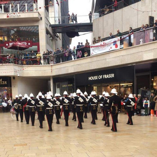 The Band of HM Royal Marines Plymouth marching in slow time to Avengers Assemble